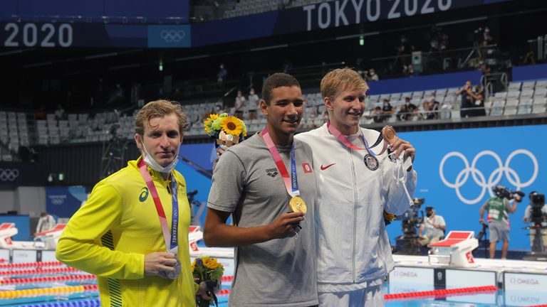 HAFNAOUI Ahmed of Tunisia (C) reacts after winning Men's 400m Freestyle Final at Tokyo Aquatics Centre in Tokyo on July 25, 2021. HAFNAOUI Ahmed won the event to claim gold medal. ( The Yomiuri Shimbun via AP Images