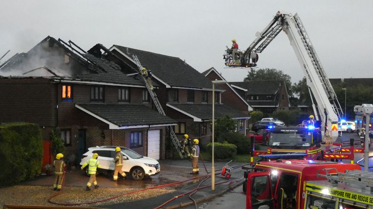 The houses are seen blackened by the lightning strike