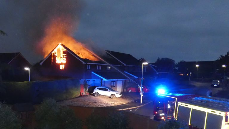 Images show the houses on fire overnight