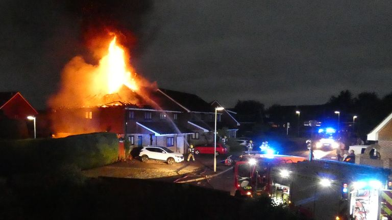 Smoke and flames engulfed the house after the strike