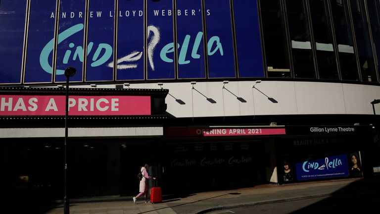 """Show signs for """"Cinderella"""" are displayed on the temporarily closed Gillian Lynne Theatre, during England's third coronavirus lockdown, in London, Friday, Feb. 26, 2021. British Prime Minister Boris Johnson announced on Monday a slow easing of one of Europe's strictest pandemic lockdowns, with indoor venues such as theatres and cinemas scheduled to open May 17. (AP Photo/Matt Dunham)"""