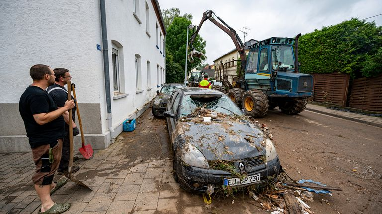 Debris being cleared after flooding near Arloff. Pic: Associated Press