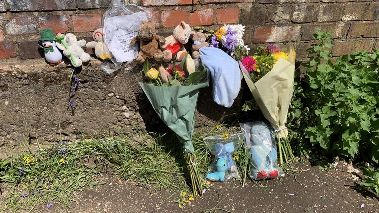 File photo dated 27/5/2021 of floral tributes left near Rough Wood country park in Walsall, where a dead newborn baby boy was found in the local canal.. A £5,000 reward is being offered for information about the suspected murder of a newborn baby whose body was found in the West Midlands canal. Issue date: Thursday July 15, 2021.