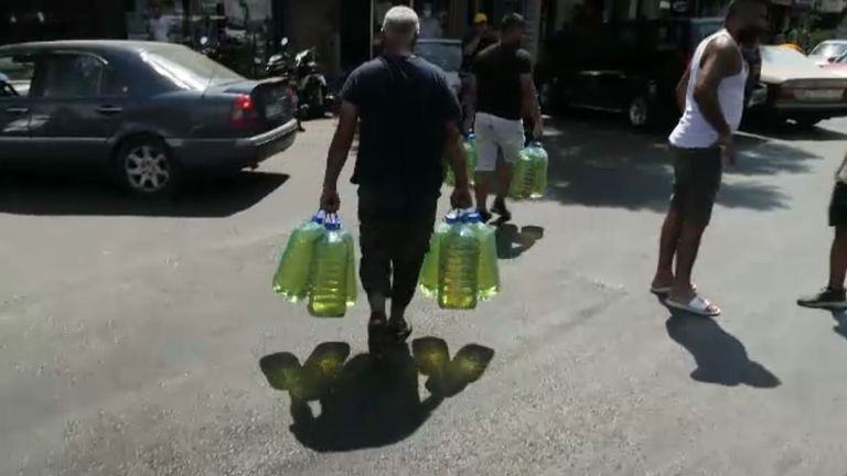 A man gathers supplies amid shortages in Beirut