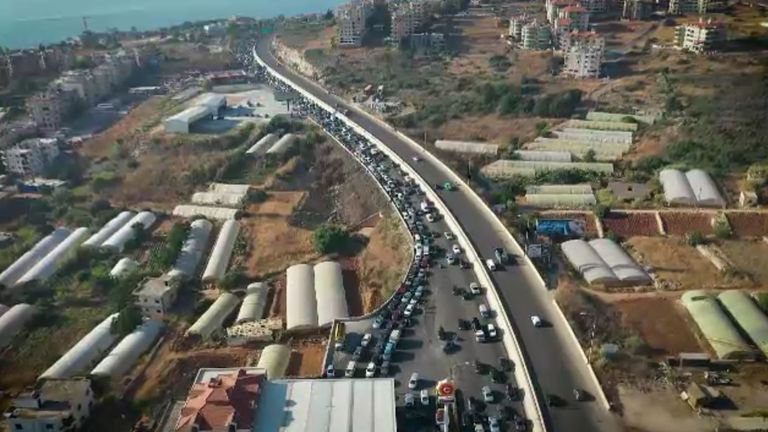 Queues of cars waiting for fuel stretch for miles