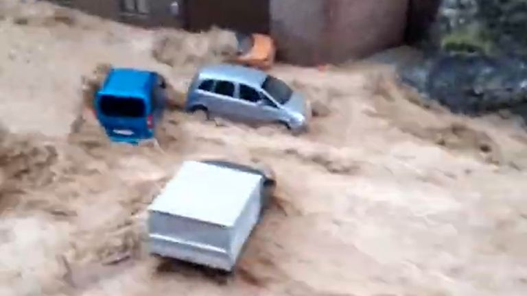 Severe flooding carried cars through Dinant, Belgium and and left heavy damage.