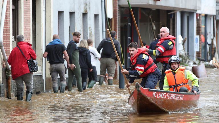 Austrian rescue team members pole their boat as they go through an area affected by floods, following heavy rainfalls, in Pepinster, Belgium, July 16, 2021. REUTERS/Yves Herman