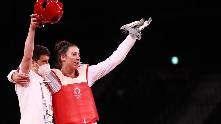 Bianca Walkden celebrates winning the bronze medal with her coach