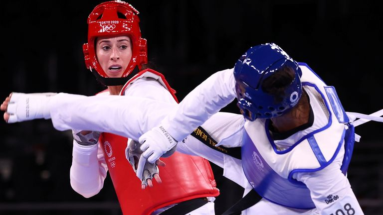Tokyo 2020 Olympics - Taekwondo - Women's Heavyweight +67kg - Quarterfinal - Makuhari Messe Hall A, Chiba, Japan - July 27, 2021. Bianca Walkden of Britain in action against Cansel Deniz of Kazakhstan REUTERS/Murad Sezer