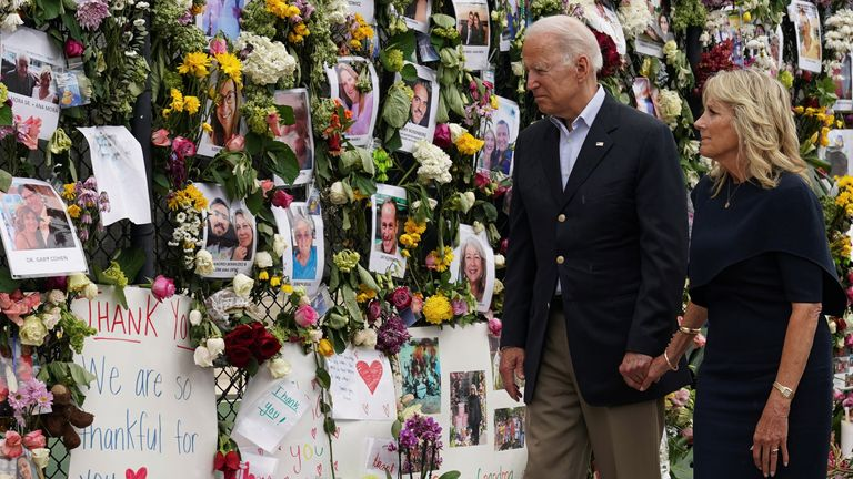 U.S. President Joe Biden and first lady Jill Biden visit a memorial put in place for the victims of the building collapse in Surfside, in Tent city area, Surfside, Florida U.S., July 1, 2021.
