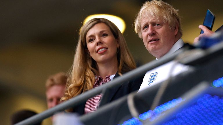 Soccer Football - Euro 2020 - Final - Italy v England - Wembley Stadium, London, Britain - July 11, 2021 Britain's Prime Minister Boris Johnson with his wife Carrie Johnson before the match Pool via REUTERS/John Sibley