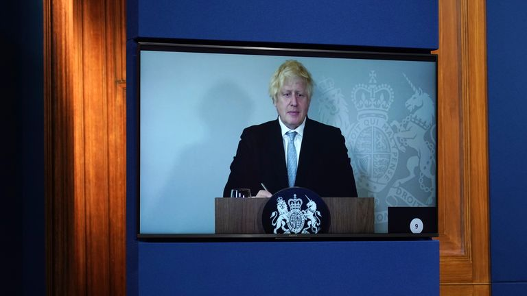 Boris Johnson leads a virtual Downing Street briefing from isolation.