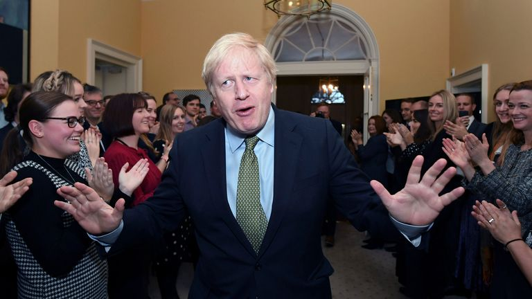 Prime Minister Boris Johnson is greeted by staff as he arrives back at 10 Downing Street, London, after meeting Queen Elizabeth II and accepting her invitation to form a new government after the Conservative Party was returned to power in the General Election with an increased majority. PA Photo. Picture date: Friday December 13, 2019. See PA story POLITICS Election. Photo credit should read: Stefan Rousseau/PA Wire