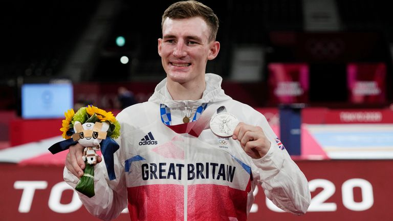 Britain's Bradly Sinden a silver medal during the medal ceremony for the taekwondo men's 68kg match at the 2020 Summer Olympics, Sunday, July 25, 2021, in Tokyo, Japan. (AP Photo/Themba Hadebe)