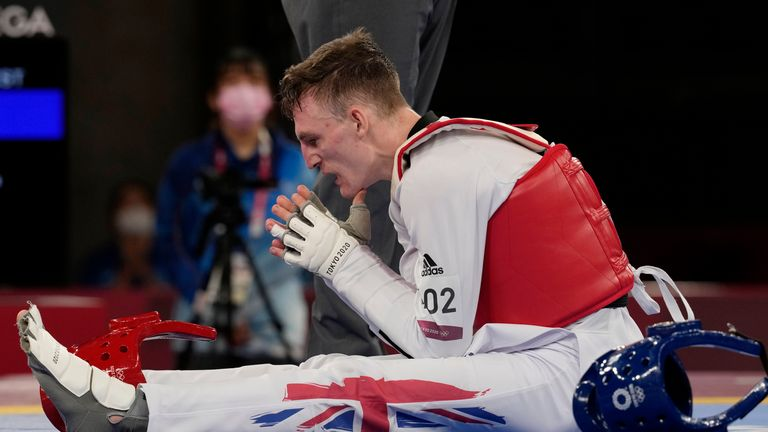 Britain's Bradly Sinden reacts after defeated for the gold medal for the taekwondo men's 68kg match at the 2020 Summer Olympics, Sunday, July 25, 2021, in Tokyo, Japan. (AP Photo/Themba Hadebe)