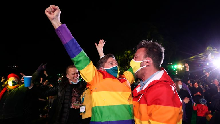 People celebrate in Brisbane after the city was picked to host the 2032 Olympics