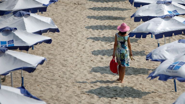A tourist enjoys the warm weather on a beach in the Black Sea coast city of Varna, about 450 km (280 miles) northeast of Bulgarian capital Sofia, June 25, 2008.