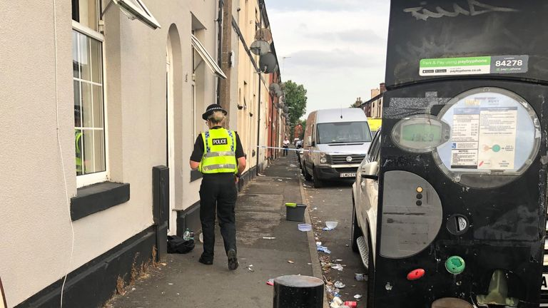 Police at the scene on East Street in Bury where a 31-year-old woman suffered severe burns and later died