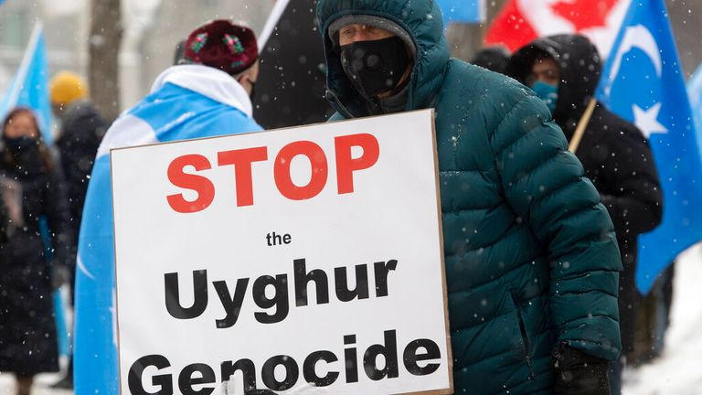 Protesters in Ottawa, Ontario in Canada criticising China's actions Pic: AP