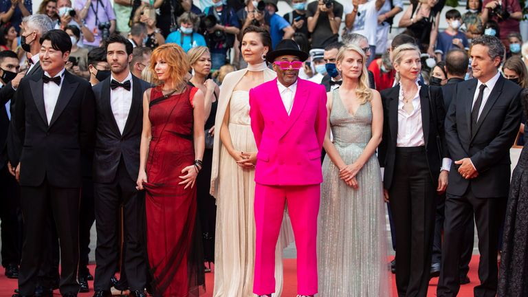 Cannes jury members Kang-Ho Song, from left, Tahar Rahim, Mylene Farmer, Maggie Gyllenhaal, Spike Lee, Melanie Laurent, Jessica Hausner, Kleber Mendonca Filho and Mati Diop pose for photographers upon arrival at the premiere of the film 'Annette' and the opening ceremony of the 74th international film festival, Cannes, southern France, Tuesday, July 6, 2021.  (Photo by Vianney Le Caer/Invision/AP)