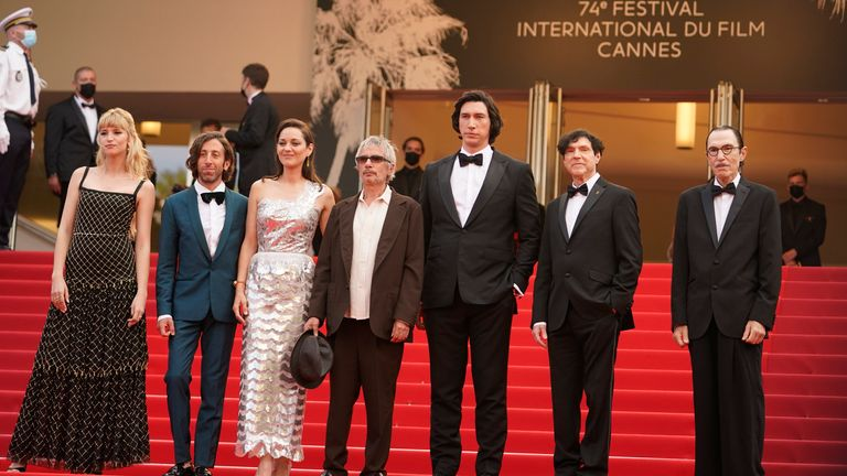 Cannes (L-R): Angele, Simon Helberg, Marion Cotillard, director Leos Carax, Adam Driver, Russell Mael, and Ron Mael at the premiere of Annette and the opening ceremony of the 74th Cannes Film Festival. Pic: AP