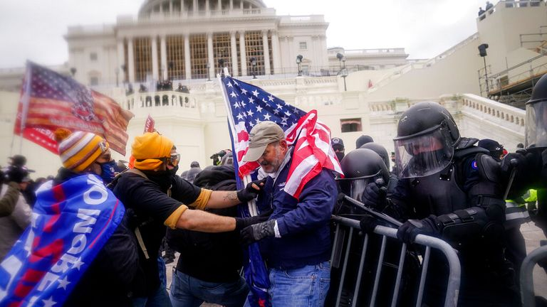 """FILE - Rioters try to break through a police barrier at the Capitol on Jan. 6, 2021, in Washington. Some of the best sources for """"Day of Rage,"""" a painstaking 40-minute video investigation into the Jan. 6 Capitol riot, were the rioters themselves — an irony given the hostility many had toward journalists. That's according to the executive in charge of the New York Times' project. (AP Photo/John Minchillo, File)"""