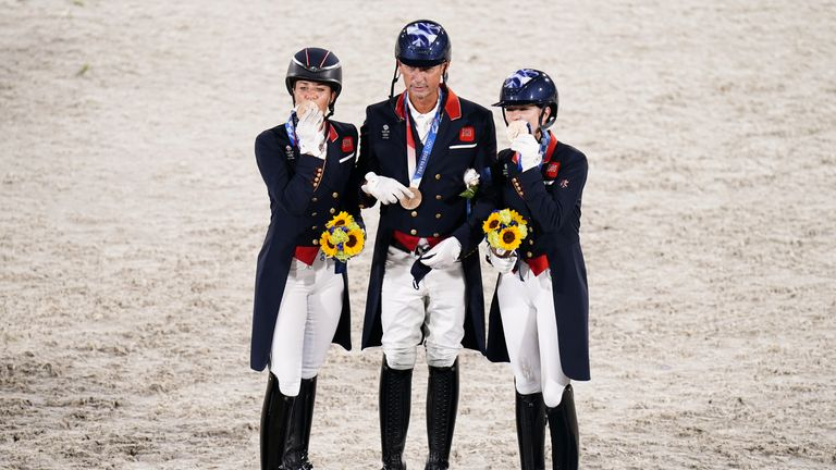 Carl Hester (centre), Charlotte Fry (right) and Charlotte Dujardin (left) with their team bronze medals