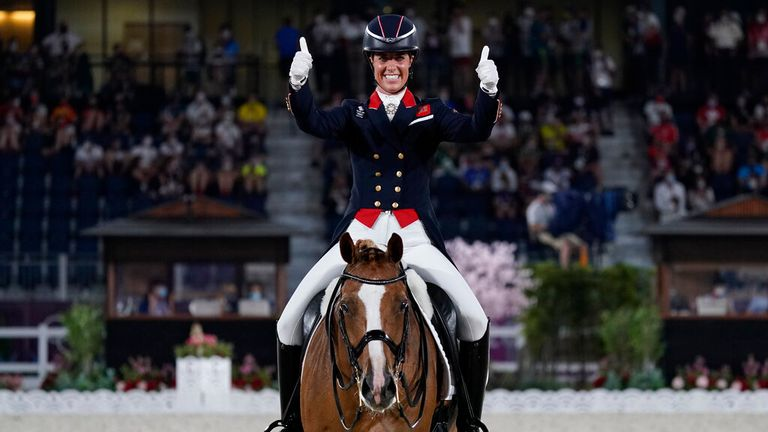 Charlotte Dujardin celebrates making British Olympic history with her bronze. Pic: AP