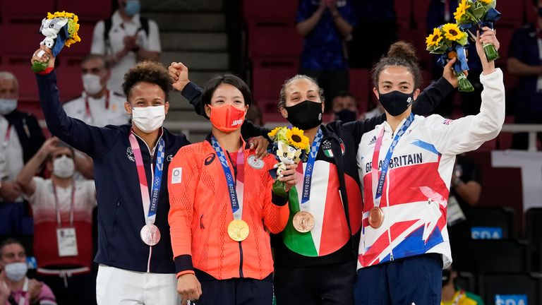 From left, silver medalist Amandine Buchard of France, gold medalist Uta Abe of Japan, and bronze medalists Odette Giuffrida of Italy and Chelsie Giles of Britain pose during the medal ceremony for women's -52kg judo at the 2020 Summer Olympics, Sunday, July 25, 2021, in Tokyo, Japan. (AP Photo/Vincent Thian)