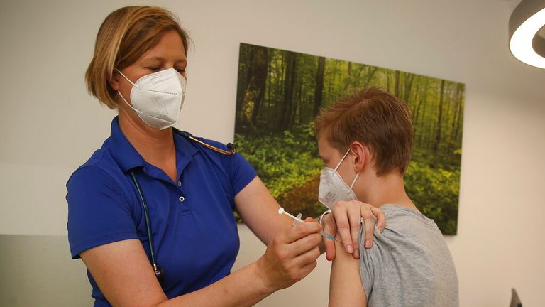 A child is given the Pfizer-BioNTech vaccine in the US. Pic: AP