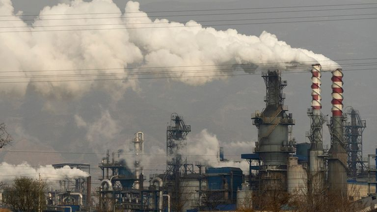 FILE  In this Nov. 28, 2019 file photo, smoke and steam rise from a coal processing plant in Hejin in central China's Shanxi Province. (AP Photo/Olivia Zhang, File)