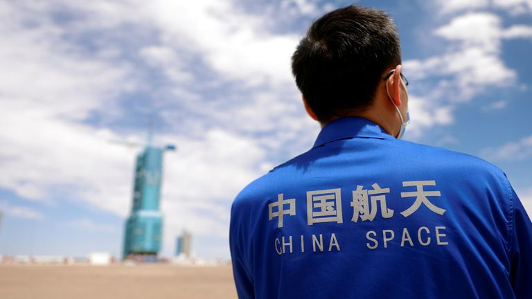 A staff member stands in front of the launch pad at Jiuquan Satellite Launch Center ahead of the Shenzhou-12 mission to build China's space station, near Jiuquan, Gansu province, China June 16, 2021