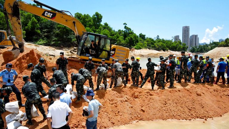 'Intense' efforts are underway to rescue the 14 construction workers trapped by flash flooding Pic: AP