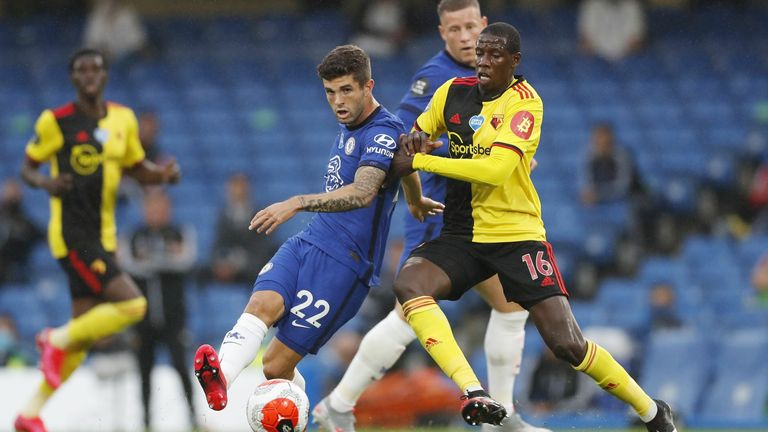 Christian Pusilic of Chelsea (L) in action against Abdoulaye Doucoure of Watford (R) last year