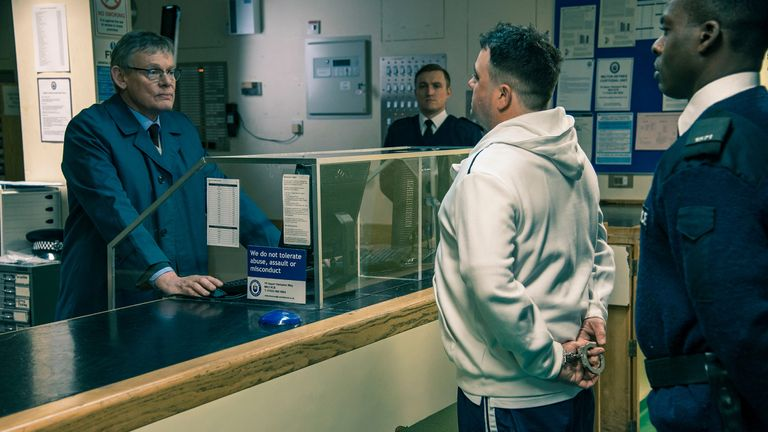 Martin Clunes (L) as DCI Colin Sutton and Celyn Jones as Levi Bellfield in the ITV series Manhunt. Pic: ITV/Shutterstock