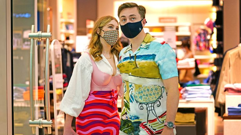 Two shoppers wearing facemasks inside a shopping centre in East London