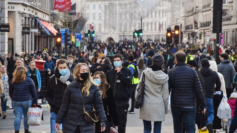 London, United Kingdom - December 5 2020: People wearing protective face masks walking on Regent Street, which was closed to vehicle traffic for a day.