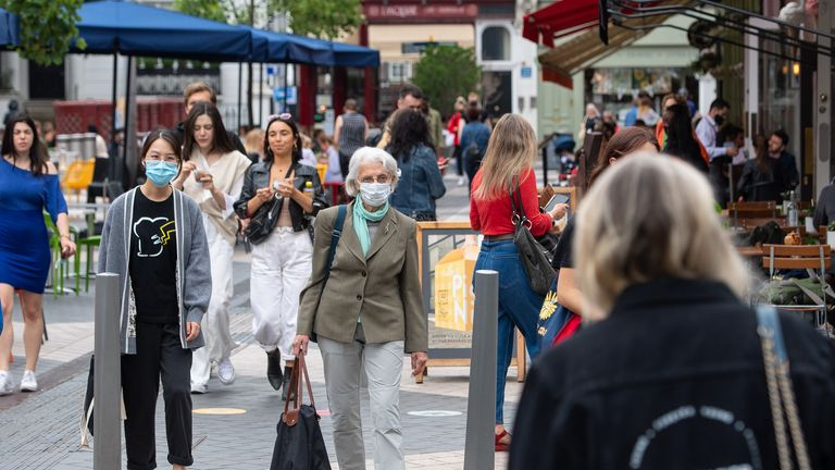 People wear face coverings in Kensington, London, as the government continues to monitor coronavirus infection levels ahead of potential end to covid restrictions on July 19th. Picture date: Tuesday June 29, 2021.
