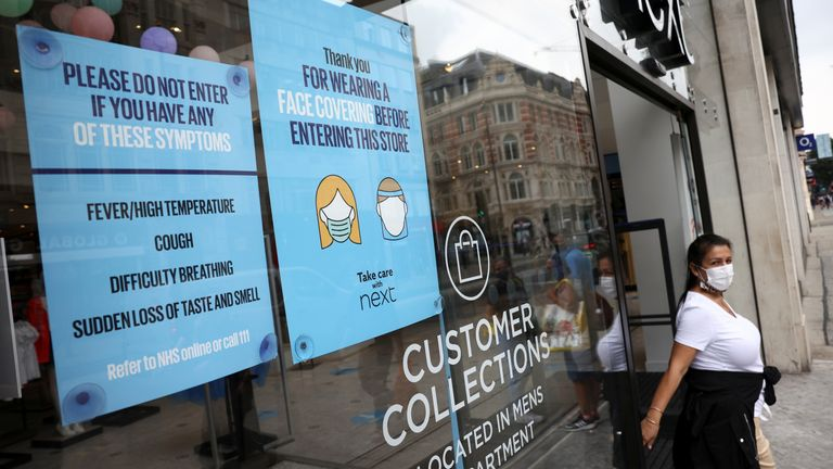 A sign asking customers to wear protective face masks is seen in the window of a shop on Oxford Street, amid the coronavirus disease (COVID-19) outbreak, in London, Britain, July 26, 2021. REUTERS/Henry Nicholls