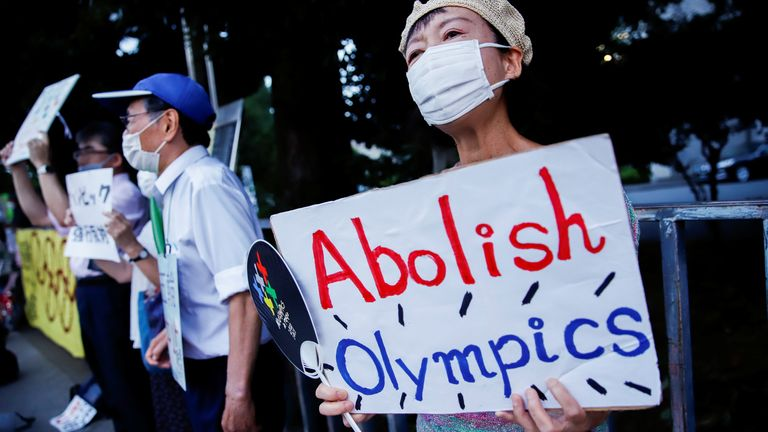 Anti-Olympic protesters gather outside Japanese Prime Minister Yoshihide Suga's office in Tokyo, Japan