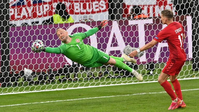Kasper Schmeichel pulled off a fantastic save to deny Maguire