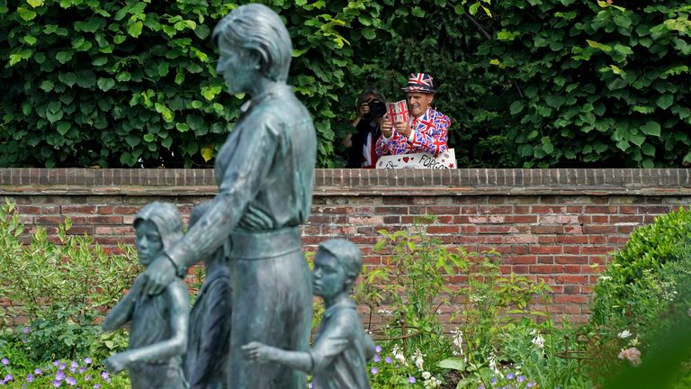 A royal fan admires the statue in Kensington Palace gardens