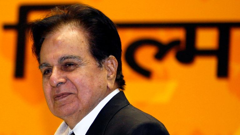 Bollywood star Dilip Kumar smiles after receiving the lifetime achievement award from India's President Pratibha Patil