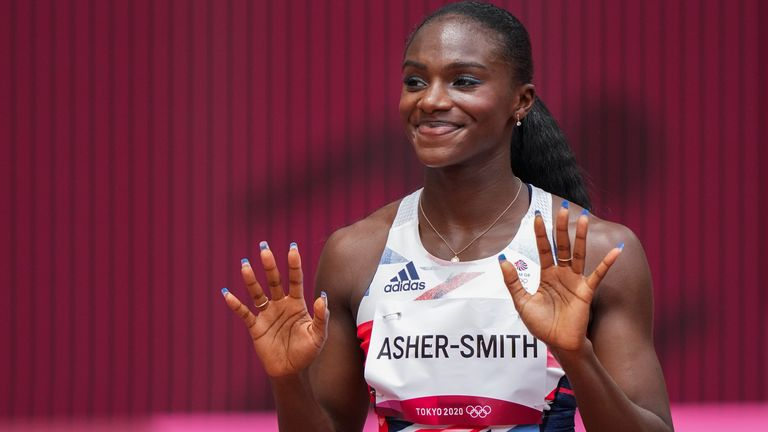 Dina Asher-Smith, of Britain, gestures ahead of her heat of the women's 100-meters at the 2020 Summer Olympics, Friday, July 30, 2021, in Tokyo. (AP Photo/Matthias Schrader)