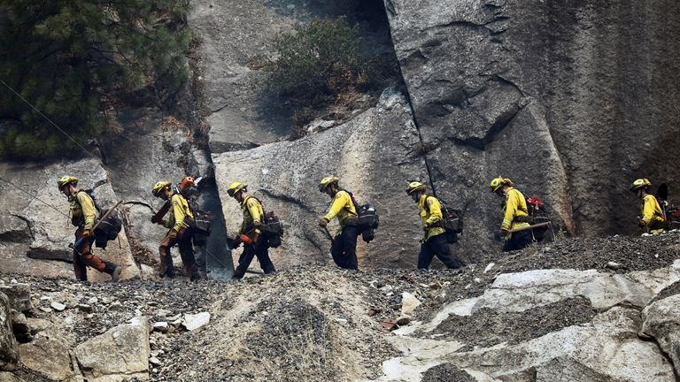Crews have been forced to hike through rugged terrain as part of the firefighting effort against the Dixie Fire