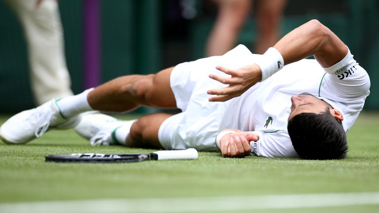 Novak Djokovic slips on the grass and falls over during his second round gentlemen's singles match against Kevin Anderson on centre court on day three of Wimbledon at The All England Lawn Tennis and Croquet Club, Wimbledon. Picture date: Wednesday June 30, 2021.