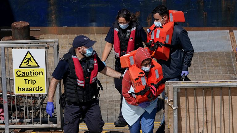 A group of people thought to be migrants are brought in to Dover, Kent, following a small boat incident in the Channel earlier on Sunday. Picture date: Sunday July 4, 2021.