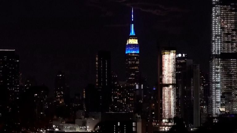The Empire State Building lit up in rotating colours in recognition of the countries competing at the Tokyo Olympics.