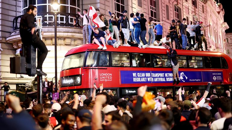 England fans celebrate reaching the Euro 2020 final in central London