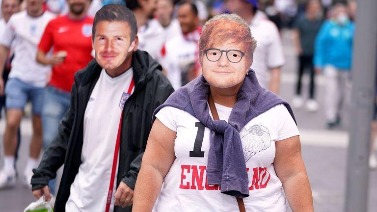 England fans sporting facemasks of Ed Sheeran and David Beckham outside Wembley